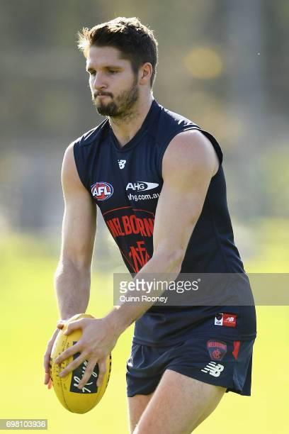 Jesse Hogan of the Demons kicks during a Melbourne Demons AFL training session at Gosch's Paddock on June 20 2017 in Melbourne Australia