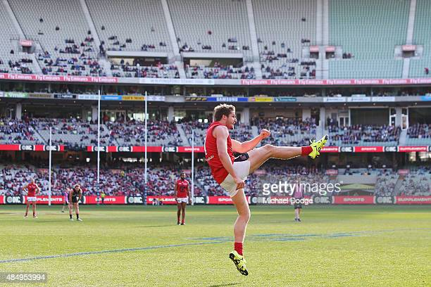 Jesse Hogan of the Demons kicks the ball in front of an empty stand during the round 21 AFL match between the Carlton Blues and the Melbourne Demons...