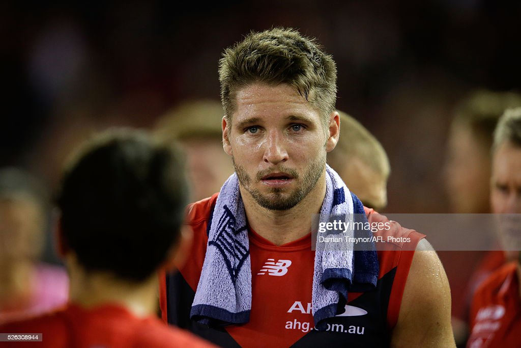 Jesse Hogan of the Demons listens in at the 3/4 time huddle during the round six AFL match between the Melbourne Demons and the St Kilda Saints at Etihad Stadium on April 30, 2016 in Melbourne, Australia.