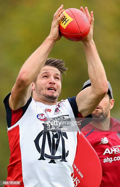 Jesse Hogan of the Demons marks during a Melbourne Demons AFL training session at AAMI Park on April 7 2015 in Melbourne Australia