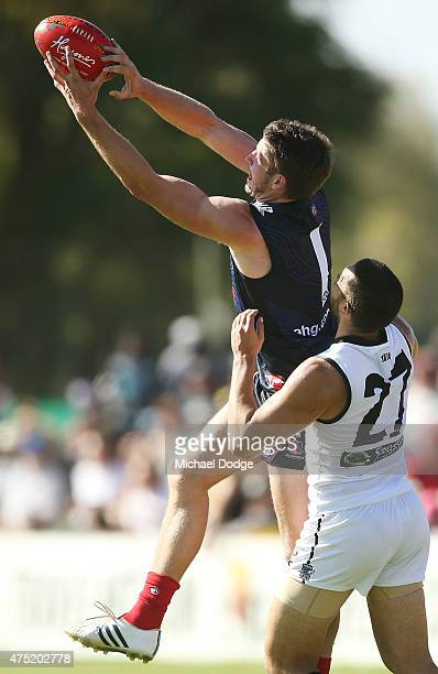 Jesse Hogan of the Demons marks the ball against Alipate Carlile of the Power during the round nine AFL match between the Melbourne Demons and the...