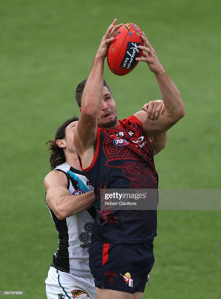 Jesse Hogan of the Demons marks the ball during the round 10 AFL match between the Melbourne Demons and the Port Adelaide Power at Traeger Park on May 28, 2016 in Alice Springs, Australia.