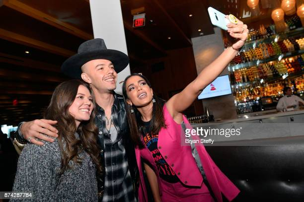 Jesse Huerta and Joy Huerta of Jesse Joy and Anitta take a selfie at the Leading Ladies Lunch during the 18th annual Latin Grammy Awards at Mastro's...