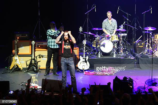 Jesse Hughes the singer of US rock group Eagles of Death Metal gestures during their concert at the Olympia concert hall in Paris on February 16 2016...