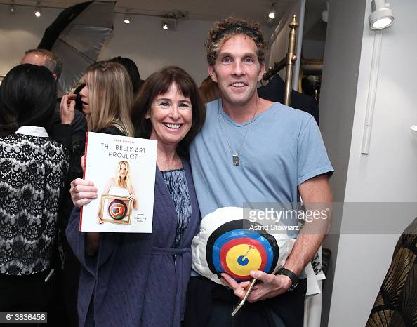 Jesse Itzler and Kate Hartson pose for a photo together as Sara Blakely and Alice Olivia celebrate the launch of 'The Belly Art Project' on October...