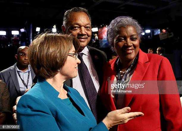 Jesse Jackson and CNN commentator Donna Brazile attend the Vice Presidential Debate between Democratic vice presidential nominee Tim Kaine and...