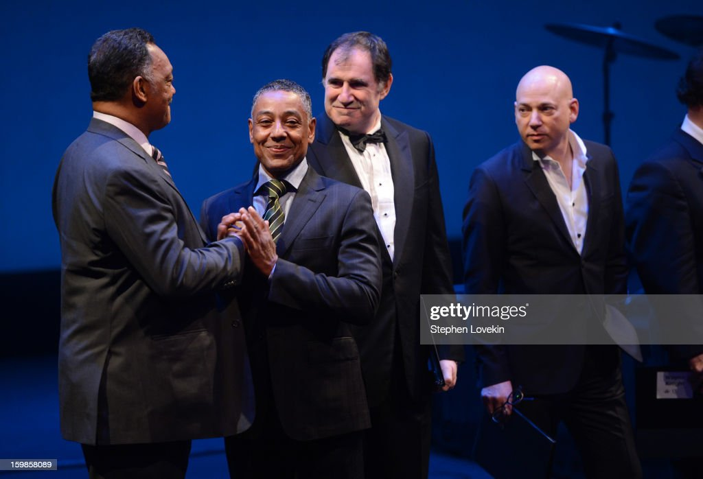 Jesse Jackson and Giancarlo Esposito share an embrace onstage as actors Richard Kind and Evan Handler look on at The Creative Coalition's 2013 Inaugural Ball at the Harman Center for the Arts on January 21, 2013 in Washington, United States.