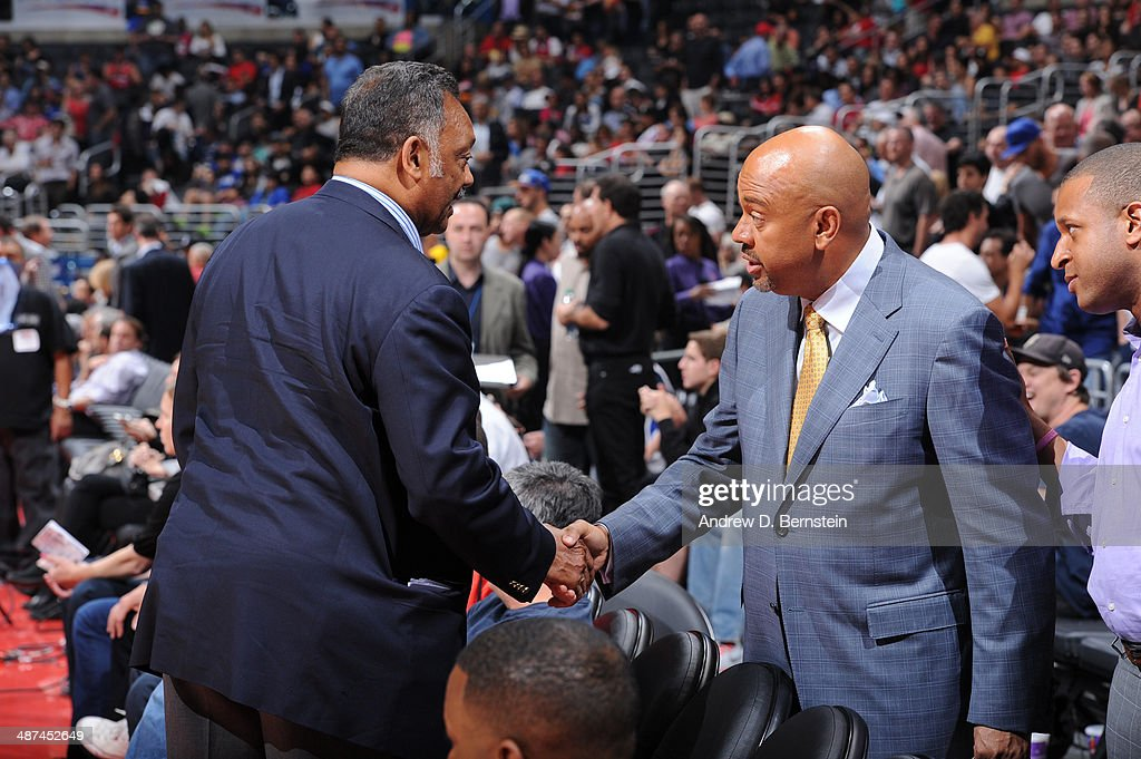 Jesse Jackson greets ESPN's Michael Wilbon in Game Five of the Western Conference Quarterfinals at Staples Center on April 29, 2014 in Los Angeles, California.