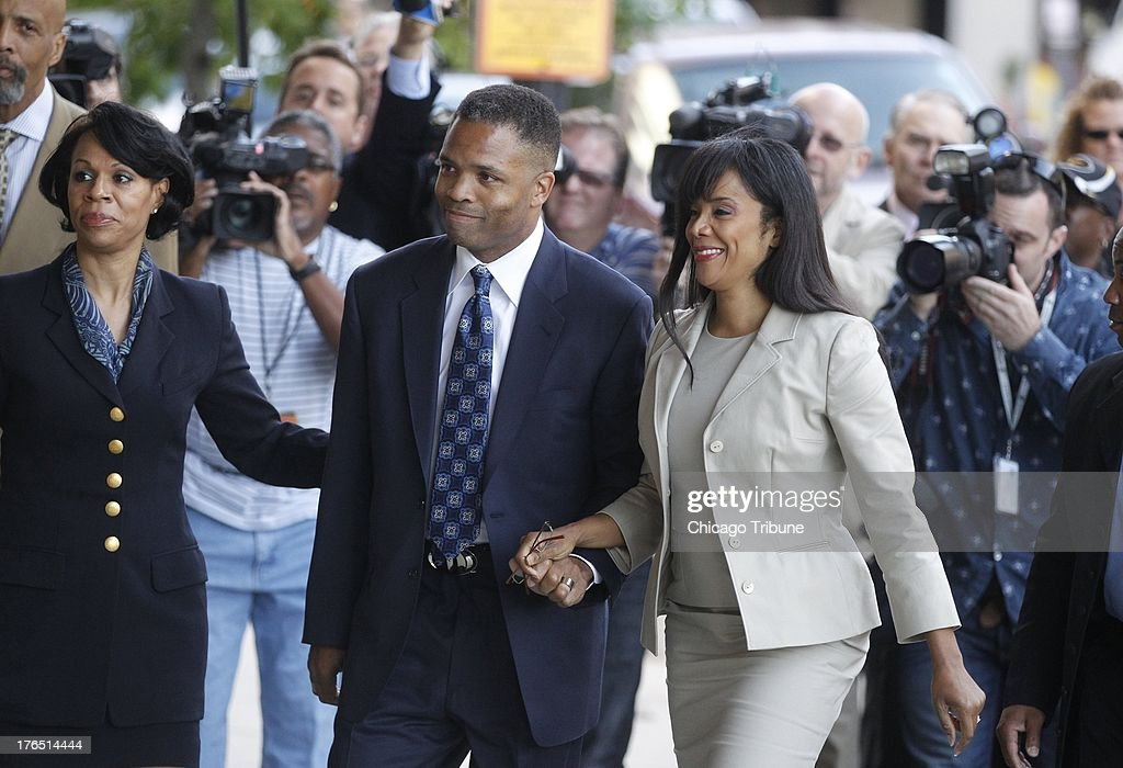 Jesse Jackson Jr. and his wife Sandi arrive at the federal courhouse in Washington, DC, for a sentencing hearing on Wednesday, August 14, 2013.