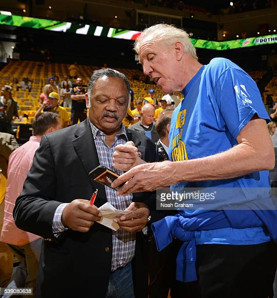 Jessie Jackson speaks with Bill Walton before the Golden State Warriors face the Cleveland Cavaliers for Game Two of the 2016 NBA Finals on June 5...