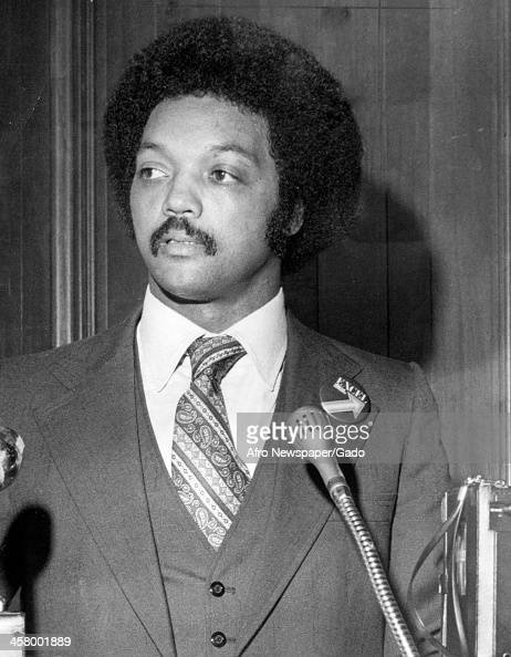 Jesse Jackson Sr as a young man with an Afro haircut delivers a speech 1978
