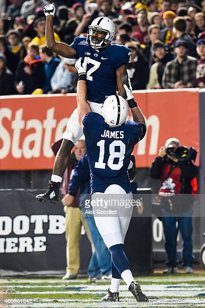 Jesse James of the Penn State Nittany Lions lifts up Geno Lewis after a touchdown in the second half during a game against the Boston College Eagles...