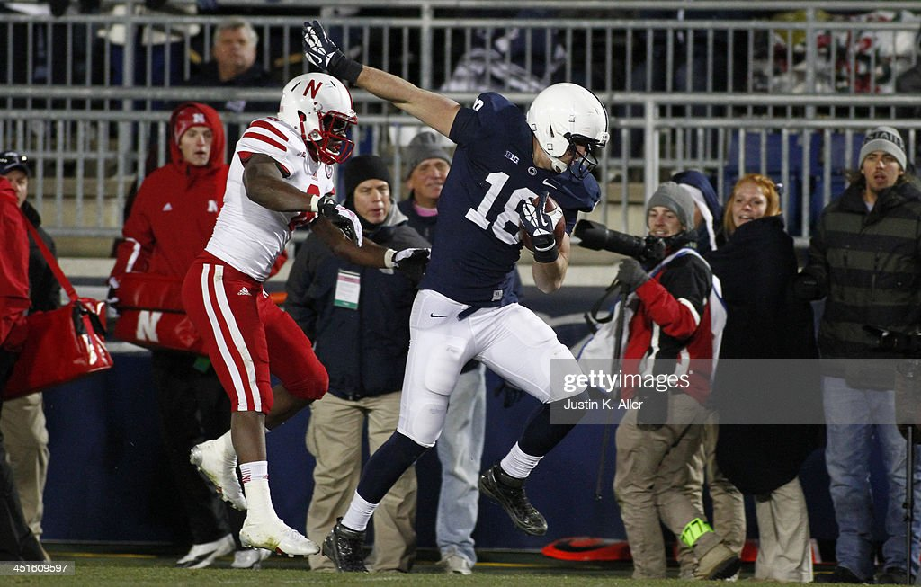 Jesse James #18 of the Penn State Nittany Lions scores on a 46 yard pass against the Nebraska Cornhuskers during the game on November 23, 2013 at Beaver Stadium in State College, Pennsylvania.