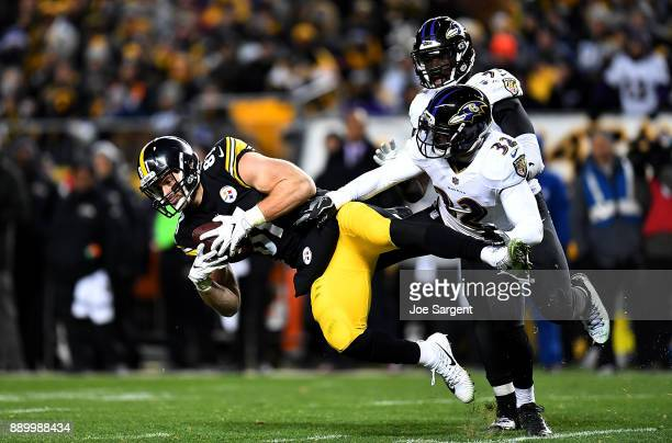 Jesse James of the Pittsburgh Steelers makes a catch in front of Eric Weddle of the Baltimore Ravens in the second half during the game at Heinz...