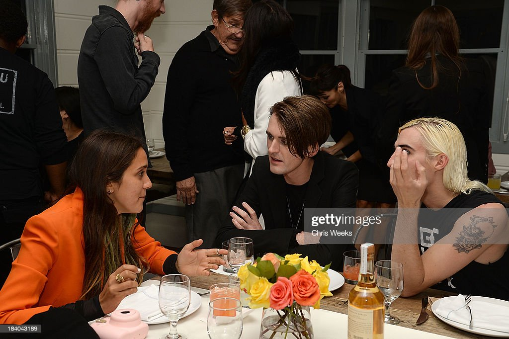 Jesse Jo Stark, fashion designer Gareth Pugh and Carson McCall attend a dinner for Pugh hosted by Chrome Hearts at Malibu Farm on October 10, 2013 in Malibu, California.