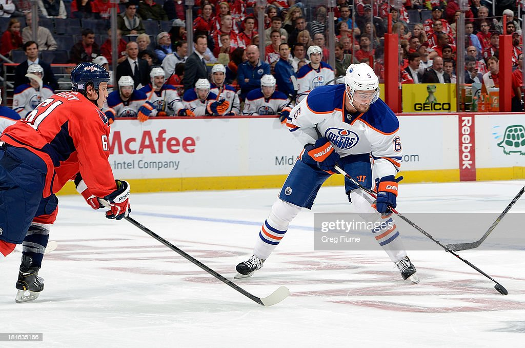 <a gi-track='captionPersonalityLinkClicked' href=/galleries/search?phrase=Jesse+Joensuu&family=editorial&specificpeople=543214 ng-click='$event.stopPropagation()'>Jesse Joensuu</a> #6 of the Edmonton Oilers brings the puck down the ice in the second period against Steve Oleksy #61 of the Washington Capitals at the Verizon Center on October 14, 2013 in Washington, DC.