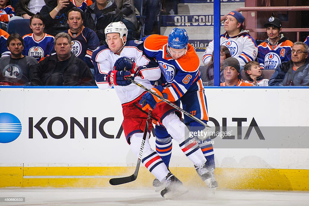 <a gi-track='captionPersonalityLinkClicked' href=/galleries/search?phrase=Jesse+Joensuu&family=editorial&specificpeople=543214 ng-click='$event.stopPropagation()'>Jesse Joensuu</a> #6 of the Edmonton Oilers collides with <a gi-track='captionPersonalityLinkClicked' href=/galleries/search?phrase=Nikita+Nikitin&family=editorial&specificpeople=722107 ng-click='$event.stopPropagation()'>Nikita Nikitin</a> #6 of the Columbus Blue Jackets during an NHL game at Rexall Place on November 19, 2013 in Edmonton, Alberta, Canada. The Oilers defeated the Blue Jackets 7-0.
