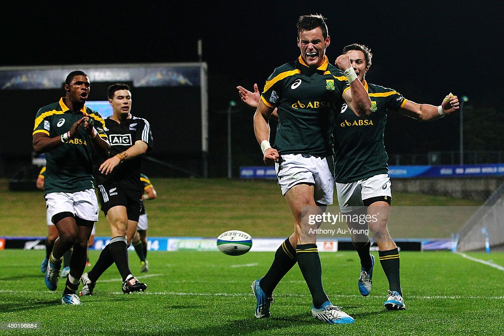 <a gi-track='captionPersonalityLinkClicked' href=/galleries/search?phrase=Jesse+Kriel&family=editorial&specificpeople=10976408 ng-click='$event.stopPropagation()'>Jesse Kriel</a> of South Africa celebrates after scoring a try during the 2014 Junior World Championships match between New Zealand and South Africa at QBE Stadium on June 6, 2014 in Auckland, New Zealand.
