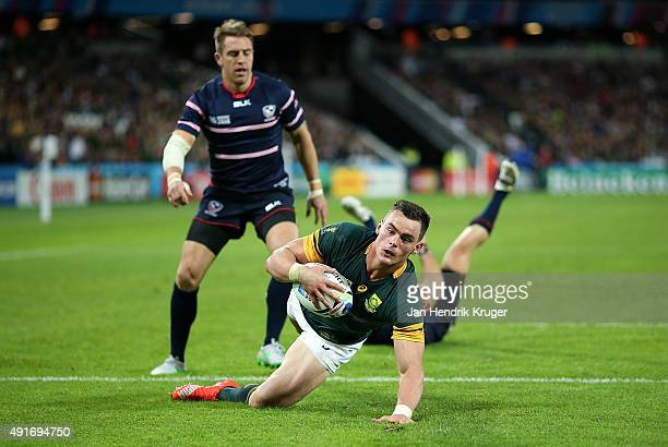 Jesse Kriel of South Africa goes over for his try during the 2015 Rugby World Cup Pool B match between South Africa and USA at Olympic Stadium on...