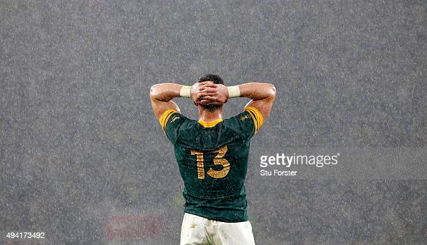 Jesse Kriel of South Africa holds his head in his hands in dejection as the rain falls during the 2015 Rugby World Cup Semi Final match between South...