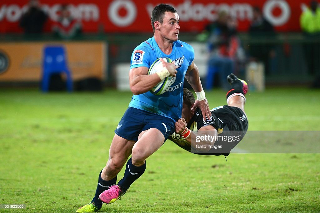 Jesse Kriel of the Bulls is tackled by Rohan Janse van Rensburg of the Lions during the Super Rugby match between the Vodacom Bulls and Emirates Lions at Lotus Versfeld Stadium on May 28, 2016 in Pretoria, South Africa.