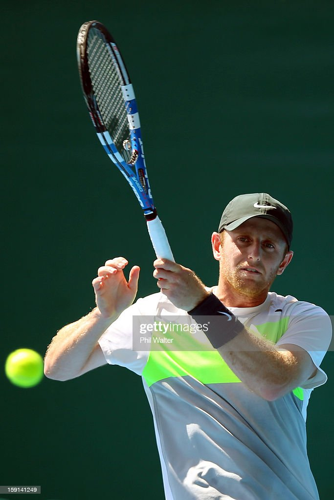 Jesse Levine of Canada plays a forehand in his second round match against Brian Baker of the USA during day three of the Heineken Open at ASB Tennis Centre on January 9, 2013 in Auckland, New Zealand.