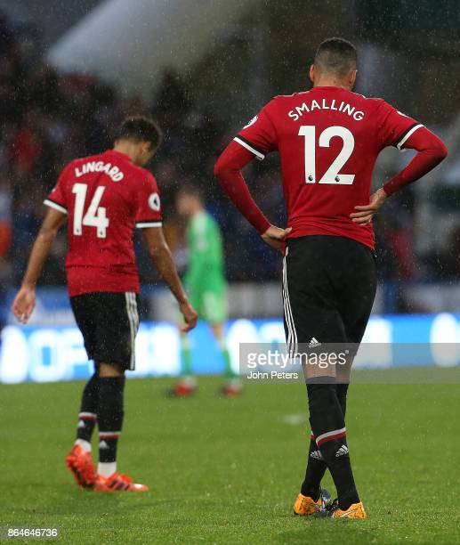 Jesse Lingard and Chris Smalling of Manchester United show their disappointment after the Premier League match between Huddersfield Town and...