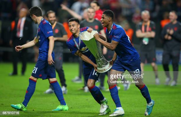 Jesse Lingard and Marcus Rashford of Manchester United celebrate with the trophy during the UEFA Europa League Final match between Ajax and...