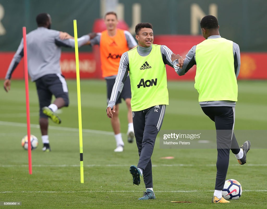 Jesse Lingard and Marcus Rashford of Manchester United in action during a first team training session at Aon Training Complex on August 22, 2017 in Manchester, England.