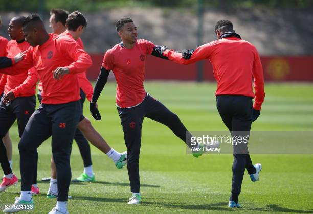 Jesse Lingard and Marcus Rashford of Manchester United warm up during a training session at the Aon Training Complex on May 3 2017 in Manchester...