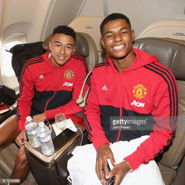 Jesse Lingard and Marcus Rashford sit on the aeroplane ahead of the club's preseason tour of the USA at Manchester Airport on July 9 2017 in...