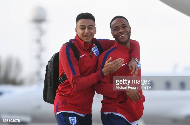 Jesse Lingard and Raheem Sterling of England walk to the plane as they leave for the International Friendly match against Germany at Birmingham...