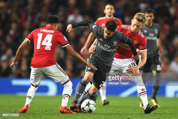 Jesse Lingard and Scott McTominay of Manchester United chase down Pizzi of Benfica during the UEFA Champions League group A match between Manchester...