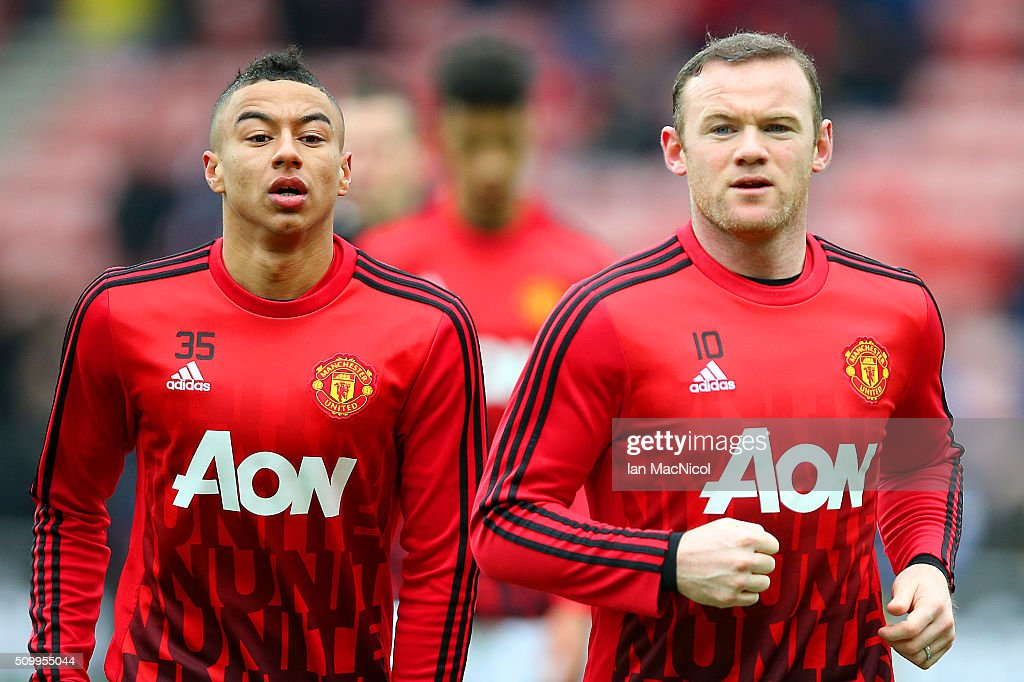 Jesse Lingard (L) and Wayne Rooney (R) of Manchester United warm up prior to the Barclays Premier League match between Sunderland and Manchester United at the Stadium of Light on February 13, 2016 in Sunderland, England.