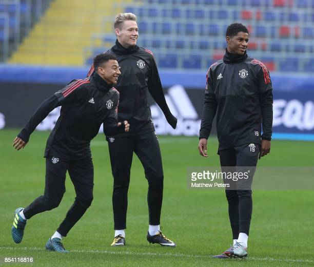 Jesse Lingard Marcus Rashford and Scott McTominay of Manchester United in action during a training session ahead of their UEFA Champions League match...