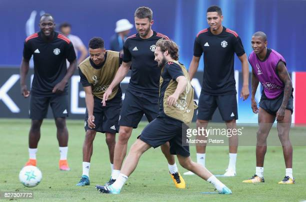 Jesse Lingard Michael Carrick and Daley Blind of Manchester United in action during a training session ahead of the UEFA Super Cup match between...