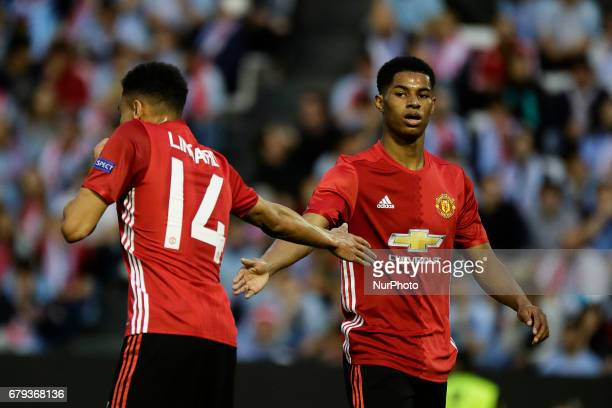 Jesse Lingard midfielder of Manchester United and Marcus Rashford forward of Manchester United reacts during the UEFA Europe League Round of 2 first...