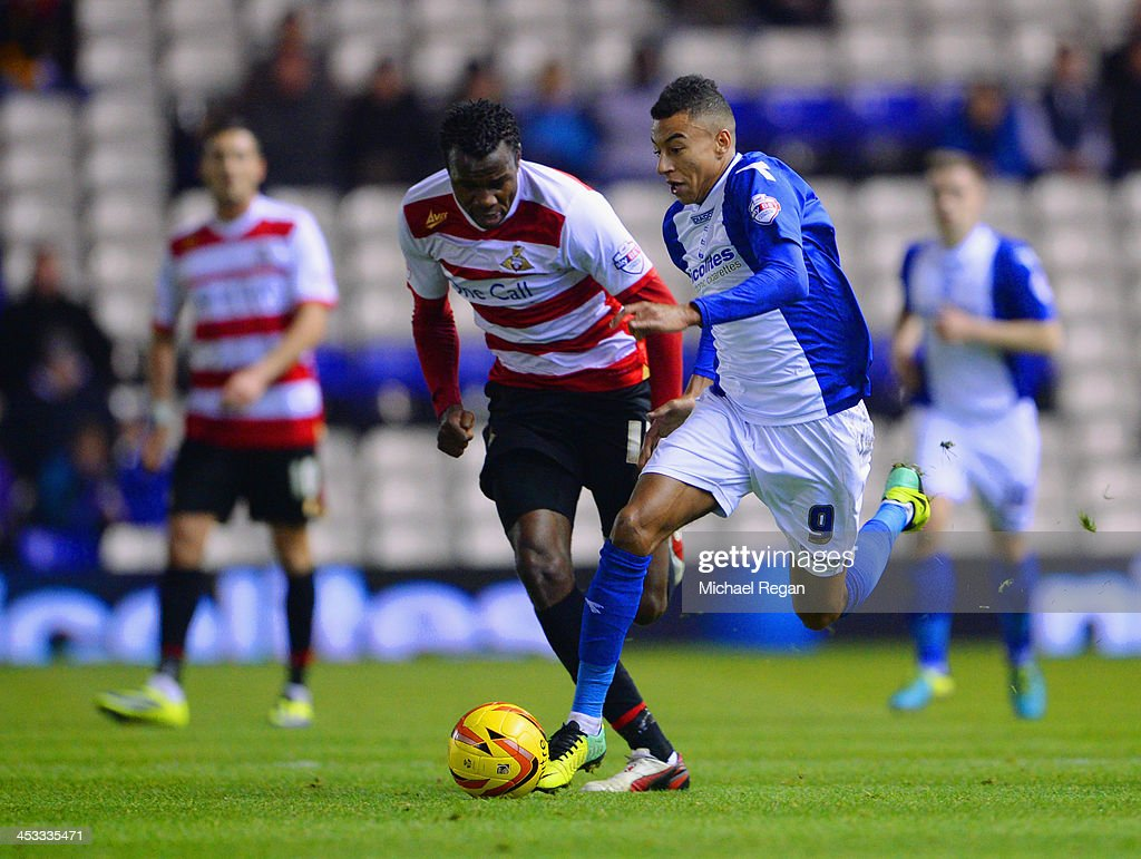 <a gi-track='captionPersonalityLinkClicked' href=/galleries/search?phrase=Jesse+Lingard&family=editorial&specificpeople=7601596 ng-click='$event.stopPropagation()'>Jesse Lingard</a> of Birmingham City in action with <a gi-track='captionPersonalityLinkClicked' href=/galleries/search?phrase=Bongani+Khumalo&family=editorial&specificpeople=4501463 ng-click='$event.stopPropagation()'>Bongani Khumalo</a> of Doncaster during the Sky Bet Championship match between Birmingham City and Doncaster Rovers at St Andrews Stadium on December 03, 2013 in Birmingham, England,