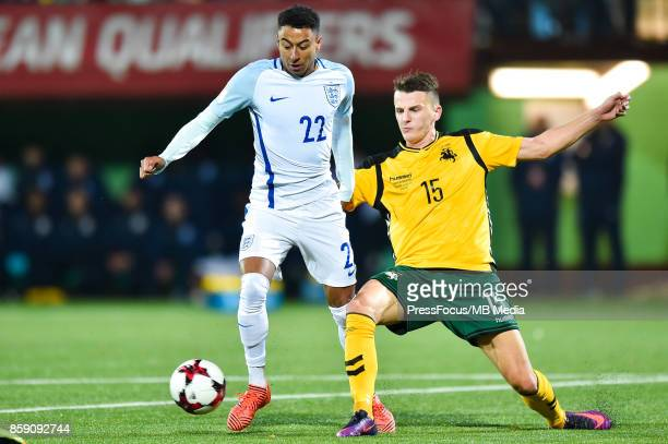 Jesse Lingard of England and Edvinas Girdvainis of Lithuania during the FIFA 2018 World Cup Qualifier between Lithuania and England on October 8 2017...