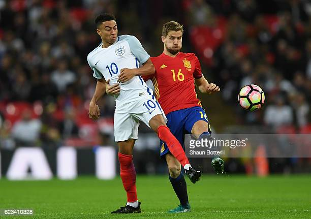 Jesse Lingard of England and Inigo Martinez of Spain battle for the ball during the international friendly match between England and Spain at Wembley...