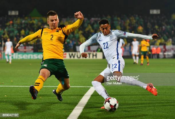 Jesse Lingard of England beats Linas Klimavicius of Lithuania during the FIFA 2018 World Cup Group F Qualifier between Lithuania and England at LFF...