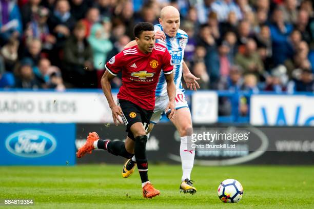 Jesse Lingard of Manchester United and Aaron Mooy of Huddersfield Town in action during the Premier League match between Huddersfield Town and...