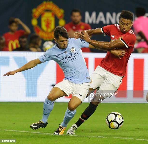 Jesse Lingard of Manchester United and Brahim Diaz of Manchester City fight for poessession of the ball in the second half at NRG Stadium on July 20...