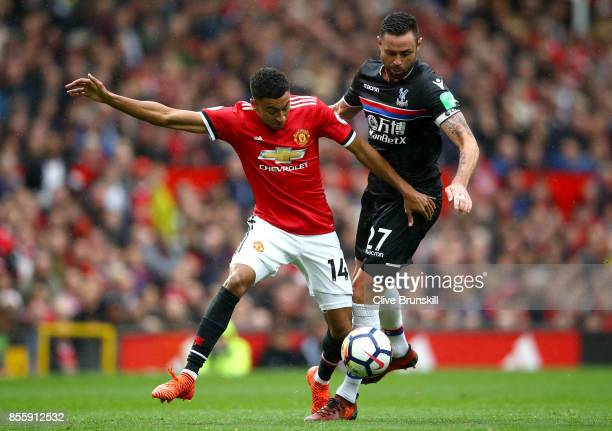 Jesse Lingard of Manchester United and Damien Delaney of Crystal Palace compete for the ball during the Premier League match between Manchester...