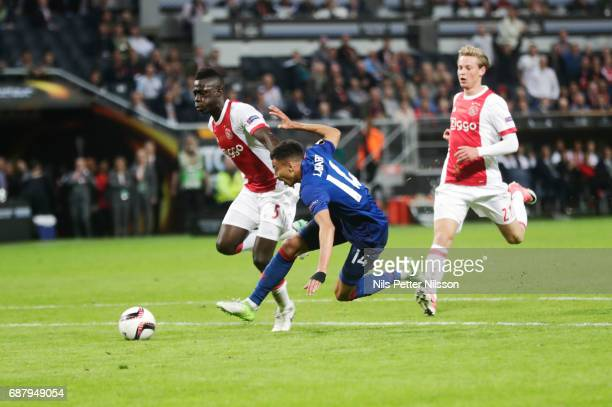 Jesse Lingard of Manchester United and Davinson Sanchez during the UEFA Europa League Final between Ajax and Manchester United at Friends Arena on...