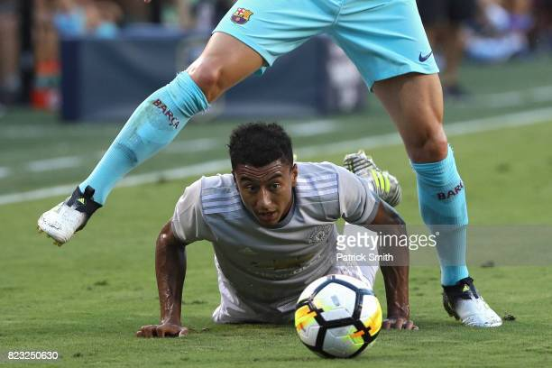 Jesse Lingard of Manchester United and Ivan Rakitic of Barcelona battle for the ball in the first half during the International Champions Cup match...