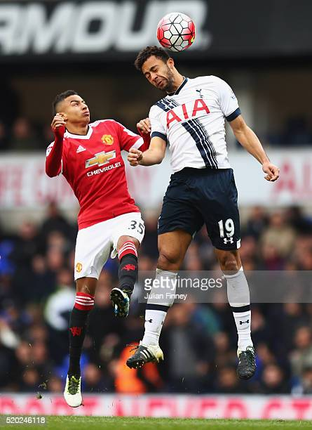 Jesse Lingard of Manchester United and Mousa Dembele of Tottenham Hotspur jump for the ball during the Barclays Premier League match between...
