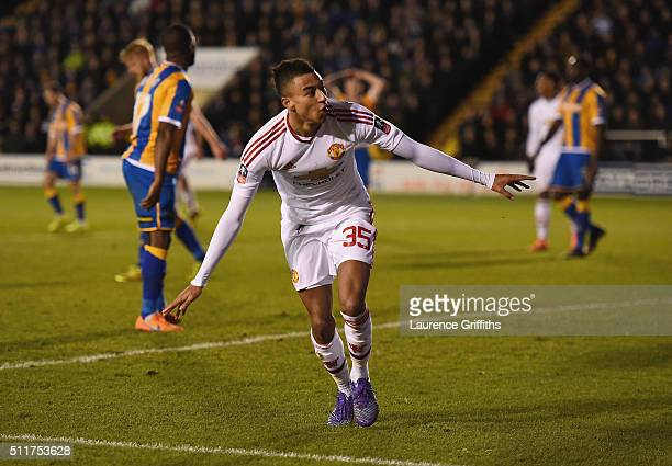 Jesse Lingard of Manchester United celebrates as he scores their third goal during the Emirates FA Cup fifth round match between Shrewsbury Town and...