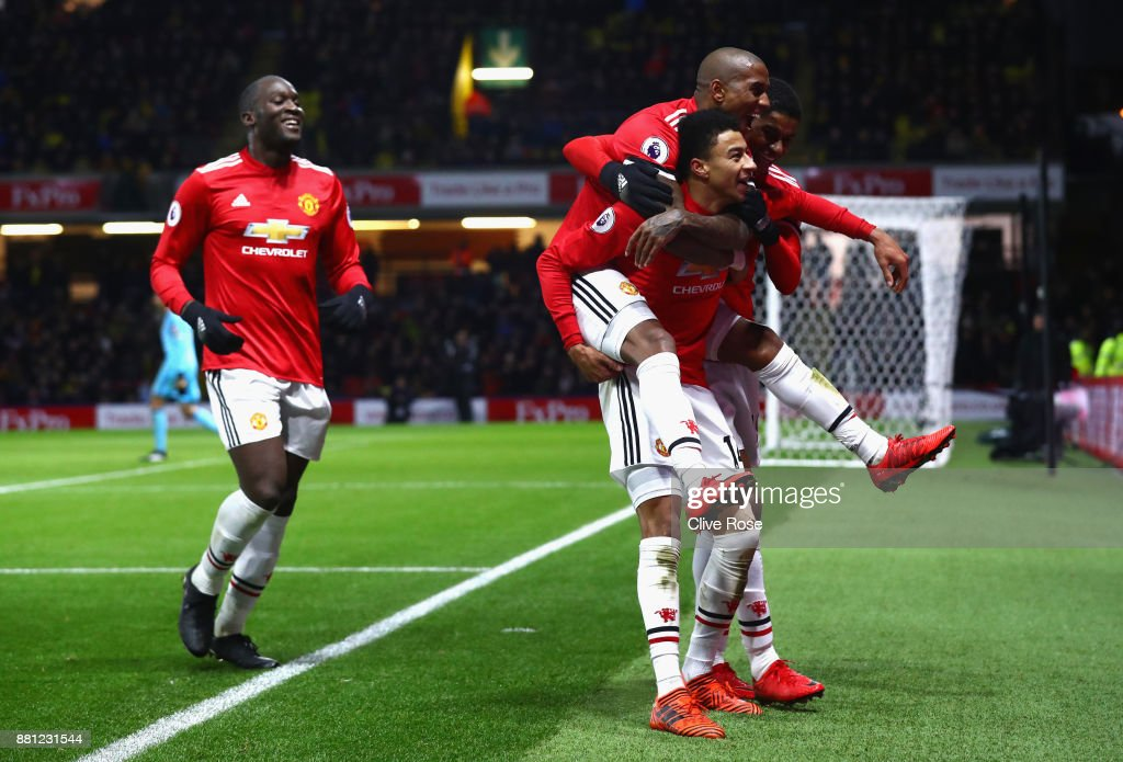 Jesse Lingard of Manchester United celebrates as he scores their fourth goal with Ashley Young, Marcus Rashford and Romelu Lukaku during the Premier League match between Watford and Manchester United at Vicarage Road on November 28, 2017 in Watford, England.