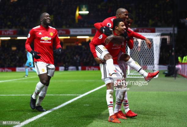 Jesse Lingard of Manchester United celebrates as he scores their fourth goal with Ashley Young Marcus Rashford and Romelu Lukaku during the Premier...